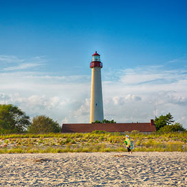 Cape May lighthouse with sandy shore in front