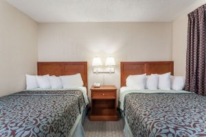 Two double beds in hotel room at Days Inn and Suites Wildwood