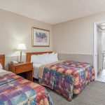 Two full size beds in two room suite at Days Inn and Suites Wildwood