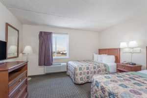 Two beds in two room suite at Days Inn and Suites Wildwood